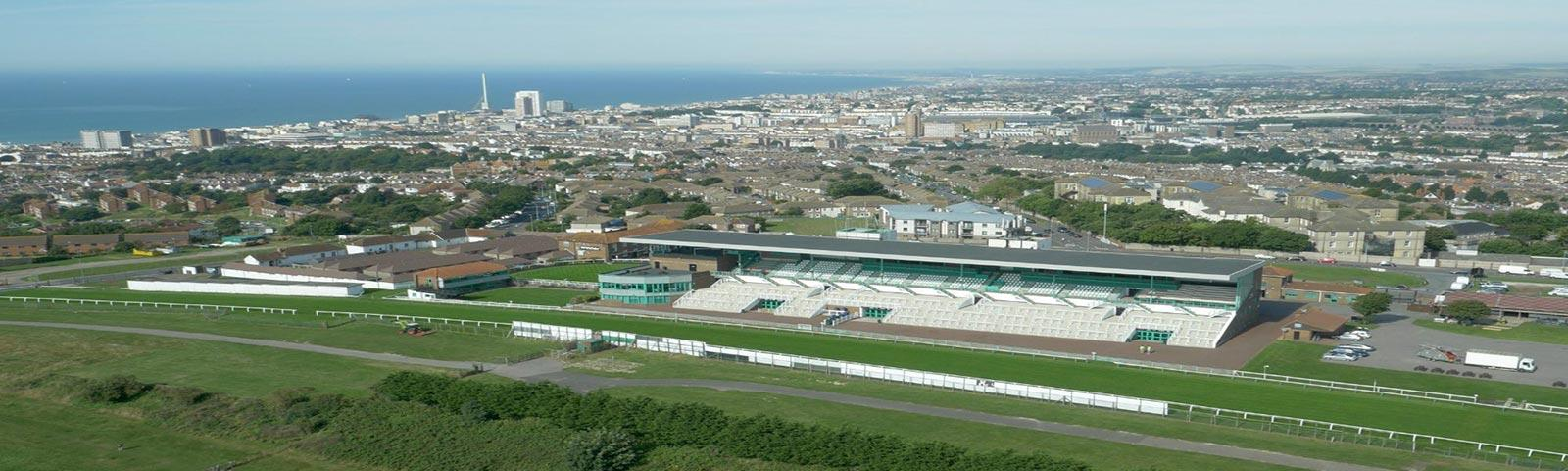 Brighton racecourse from the air with the coast in the background